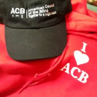 A sweatshirt that says I Love ACB and love is represented by a heart. Please note: Hat not for sale.